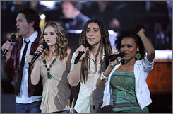 Road trip: Michael Johns, left, Kristy Lee Cook, Jason Castro and Syesha Mercado are among the top 10 finalists who will be part of this summer's American Idols Live tour.