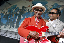 Heart of the festival: Blues guitarist Little Freddie King and jazz vocalist John Boutt are regular performers at the New Orleans Jazz & Heritage Festival.