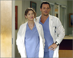 Look sharp: Residents Meredith (Ellen Pompeo) and Alex (Justin Chambers).