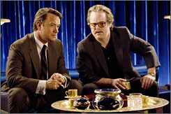 On the warpath: Tom Hanks and Philip Seymour Hoffman plot in Charlie Wilson's War.