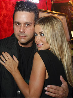 Carmen Electra has elected to try marriage again with musician Rob Patterson.