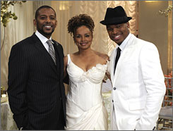 Singer Ne-Yo, far right, poses with Darnell Williams and Debbi Morgan who play Jesse and Angie Hubbard on All My Children.