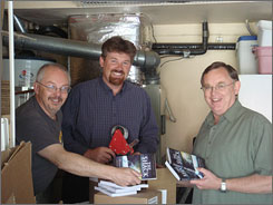 Garage warehouse: William P. Young, left, author of The Shack, helps publishers Brad Cummings and Wayne Jacobsen pack books for shipping.