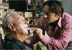 Mathieu Amalric, right, cares for Max Von Sydow in the Oscar-nominated The Diving Bell And The Butterfly.
