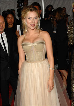 Scarlett Johansson, who got engaged to actor Ryan Reynolds, showed her diamond ring at the Metropolitan Museum's Costume Institute gala.