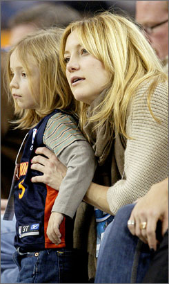 "Thrill Ryder: Kate Hudson checks out a basketball game with 4 year-old-son Ryder back in January. Hudson says  ""there's nothing like"" motherhood."