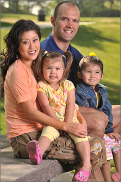Together: Olympic figure skater Kristi Yamaguchi, husband Bret Hedican and daughters Emma, 2 and Keara, 4, moved to L.A. for the show.