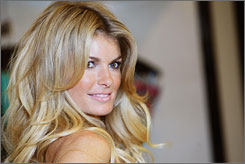 To the Maxim: In addition to her No.1 hot spot, Marisa Miller is a Victoria's Secret angel and this year's Sports Illustrated swimsuit issuse cover model.