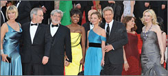 Kate Capshaw, left, Steven Spielberg, George Lucas, Melody Hoffman, Calista Flockhart, Harrison Ford, Karen Allen and Cate Blanchett attend the Indiana Jones and the Crystal Skull premiere in Cannes Sunday.