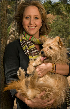 Brooke Smith, who plays Dr. Erica Hahn, cuddles with her dog, Stitch.