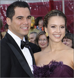Alba and Cash, seen here at February's Academy Awards, quietly tied the knot on Monday. They're expecting their first child soon.