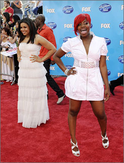 """They're hip: Previous winners Jordin Sparks, left, and Fantasia walk the carpet at Nokia Theatre. Fantasia now has """"wild side"""" bright-red hair."""