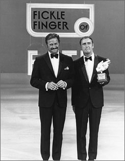 Bet your sweet bippy: Dan Rowan, left, and Dick Martin  were hosts of the groundbreaking variety show Laugh-In.