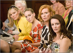 Kim Cattrall, left, Sarah Jessica Parker, Cynthia Nixon and Kristin Davis star in Sex and the City.