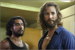 Oddly not stranded: Sayid (Naveen Andrews), left, and Desmond (Henry Ian Cusick) in &quot;The Constant,&quot; which Lost executive producer Damon Lindelof says was crucial in laying out the hit ABC series' rules for time travel.