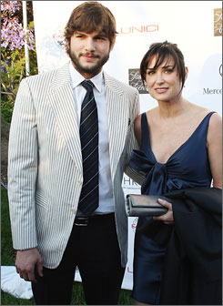 """We love it, and we really believe in it,""  Demi Moore, shown here with  husband Ashton Kutcher, said about the charity event."