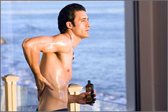 Clothing optional: Actor and underwear model Gilles Marini steams up the screen as Samantha's naked neighbor in Sex and the City: The Movie.