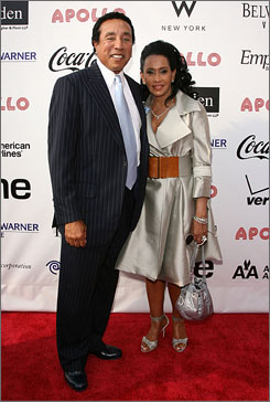 Star of the night: Smokey Robinson, with wife Frances,  was inducted into the Apollo's hall of fame.