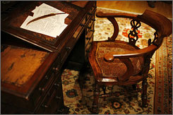 Charles Dickens' writing desk and chair was sold in a benefit auction for the Great Ormond Street children's hospital in London.