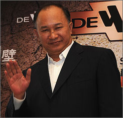 A stuntman died and six were injured on the set of director John Woo's latest film.