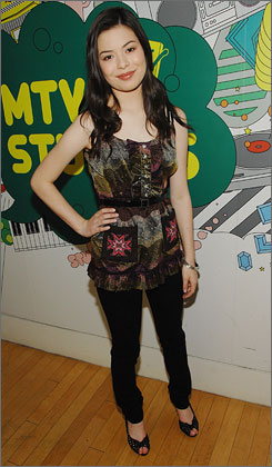 Actress and singer Miranda Cosgrove poses backstage after making an appearance on MTV's Total Request Live.
