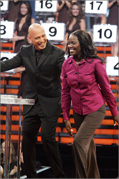 Winning game: Howie Mandel with  Deal contestant Nondumiso Sainsbury.