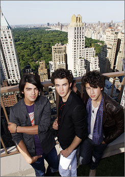 Higher power: Joe, left, Kevin and Nick Jonas, who have a tour starting July 4 and an album due Aug. 12, are just &quot;Christian guys in a rock 'n' roll band,&quot; Joe says. All their songs are &quot;also about our relationship with God.&quot;