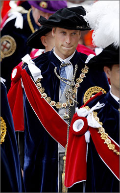 Prince William wears the traditional ostrich feather hat after his knighting ceremony Monday.