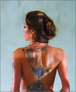 Her mark on film: Angelina Jolie says she got to show her many tattoos in Wanted, out June 27, and even more were added in makeup for her character, Fox.