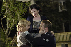 They'll get through this: The irrepressible Kit (Abigail Breslin) with her parents, played by Julia Ormond and Chris O'Donnell