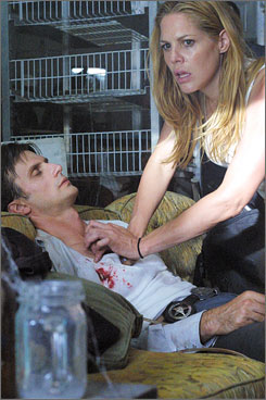In the line of duty: Mary Shannon (Mary McCormack) tries to help partner Marshall Mann (Frederick Weller).