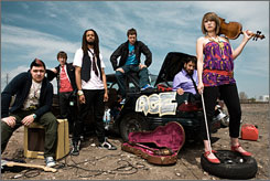"""Flobots: """"The band doesn't fit neatly into a specific genre,"""" says Jesse Walker, second from left. The other Flobots: Andy Guerrero, left, Brer Rabbit, Jonny 5, Kenny O. and Mackenzie Roberts. Nationally released album Fight With Tools is already a 100,000-seller."""