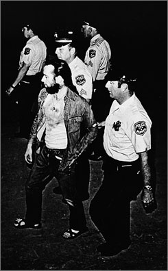 "Busted: Milwaukee police lead Carlin off the Summerfest grounds  July 22, 1972, after he was arrested for using the ""Seven Dirty Words."""