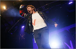 La Vida live: Coldplay's Chris Martin gets the crowd fired up in New York on Monday night during a free concert at Madison Square Garden.