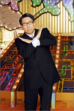 X marks the show: Judge Boboo handles the hosting duties on I Survived a Japanese Game Show.
