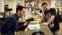 Joey Fatone listens as supermarket  manager Eric Sustin auditions for TLC's new series the Singing Office.