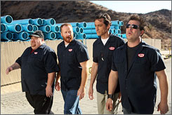 Clocking in this Sunday: Jay Leggett, left, Michael Coleman, David Pasquesi and Mitch Rouse improvise most of their lines as four blue-collar buddies who work together at a factory of some sort in Wetdirt, Ill.