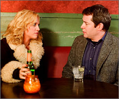 Brittany Snow and Matthew Broderick discuss their choices over drinks in a scene from Finding Amanda.