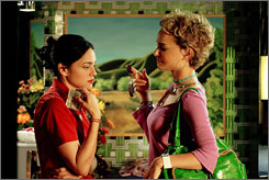 Learn a thing or two: Singer Norah Jones, left,  makes her film debut alongside film veteran Natalie Portman in My Blueberry Nights.