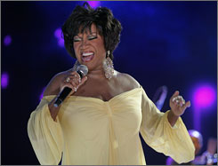 Diva moment: Patti LaBelle belts out a note during a tribute to her and her group, Labelle, at the Essence festival. The reunited trio, with Nona Hendryx and Sarah Dash, hit the stage together Saturday to sing Lady Marmalade.