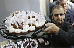 Ringo Star serves up the cupcakes at a soireee Monday at Chicago's Hard Rock Cafe, marking his 68th birthday.