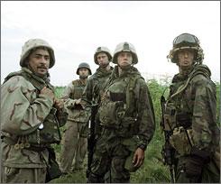 Generation Kill: Nabil Elouahabi, left, Lee Tergesen, Alexander Skarsgard, Stark Sands and Rudy Reyes in HBO miniseries.