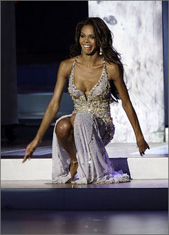 Crystle Stewart, Miss USA, falls down during the evening gown segment of the Miss Universe 2008 pageant in Nha Trang, Vietnam.