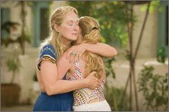 Mamma musical: Meryl Streep  comforts Amanda Seyfried.
