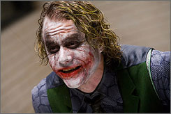 Oscar talk already building: Heath Ledger's co-stars say the actor, whose death in January stunned Hollywood, immersed himself in the disturbing persona. The Dark Knight opens Friday.