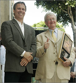 Film critics Richard Roeper, left, and Roger Ebert will no longer be part of At the Movies.