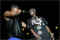 No holding back: Rappers Chuck D, left, and Flavor Flav of Public Enemy perform Friday during Chicago's Pitchfork Music Festival.