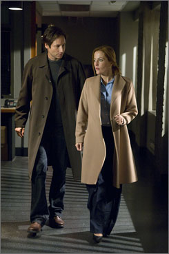 No mythology: Mulder (David Duchovny) and Scully (Gillian Anderson) look into kidnappings that aren't alien-related in Believe.