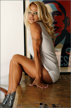 Pamela Anderson poses for a photograph in her home in Malibu, Calif.