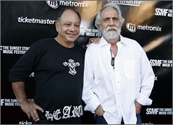 Cheech Marin, left, and Tommy Chong hang out at the Sunset Strip Music Festival in Los Angeles last month.